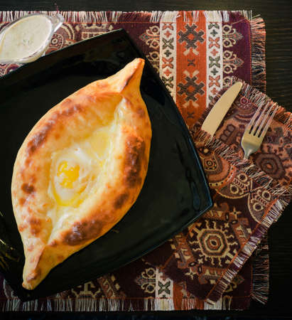 georgian cuisine, khachapuri with its white sauce Stock fotó