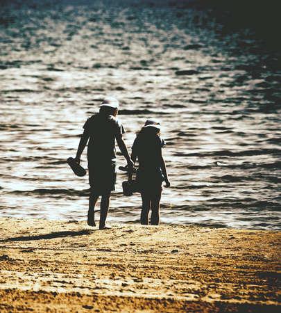 pair of children on sandy beach Stockfoto