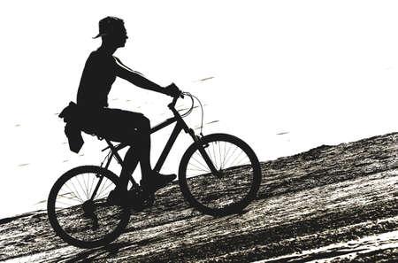 biker on the sandy beach Imagens