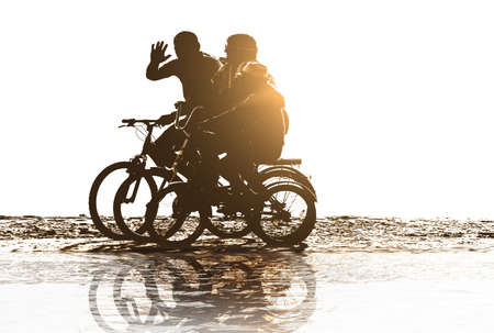 positive family rides bicycles on beach