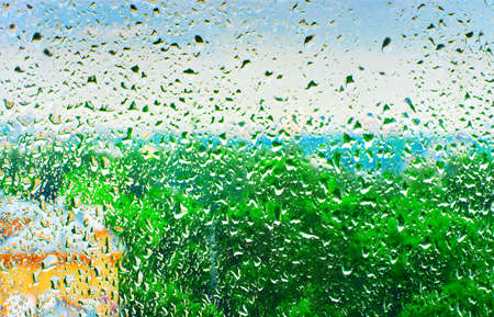 abstract pictorial view from wet glass