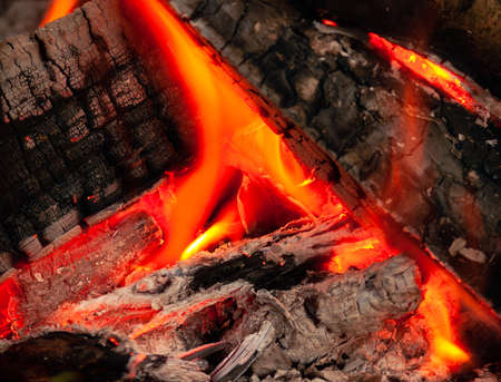 firewood burning in fireplace at night