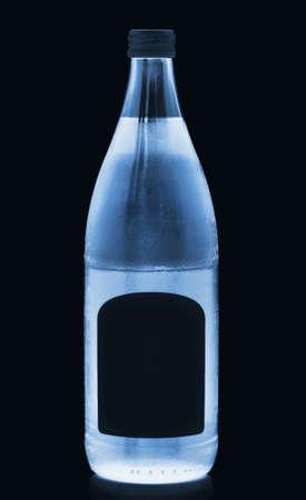 icy bottled drink in dark 写真素材