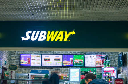 Russia 2020: people stands in the Subway fast food restaurant