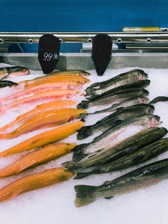 fresh salmon trout fishes on market shelf Фото со стока