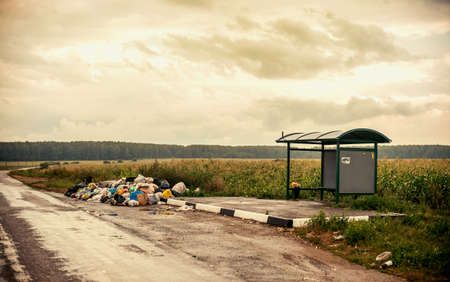 trash dump on rural bus stop