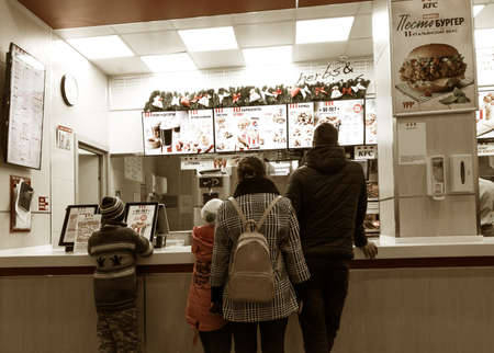 Russia 2020: family stands in the Kentucky Fried Chicken (KFC) fast food cafe