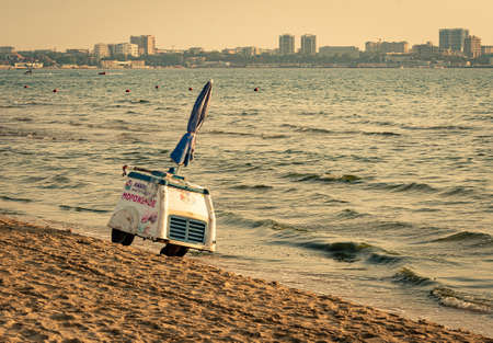 Anapa, Russia 2020: closed retro ice-cream cart is standing on city beach 新闻类图片