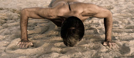 push-up exercise on sandy beach
