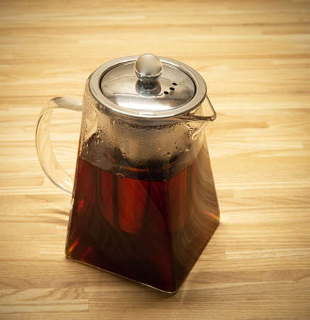 still-life with the glassy brewing teapot