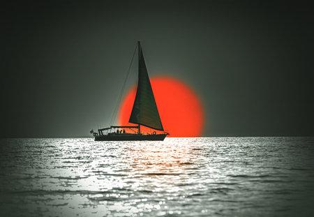 classic sail yacht at sunset