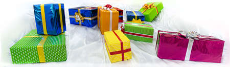 colorful gift boxes on stilized snow 免版税图像