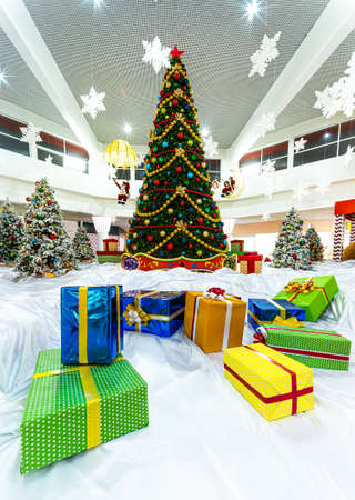 gift boxes under Christmas tree, indoor
