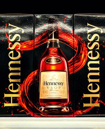 2020: composite design of Hennessy elite cognac packages in wine shop