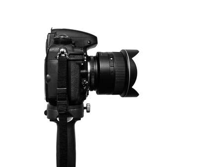 DSLR photo camera + wide angle lens standing on heavy tripod against the 255 white