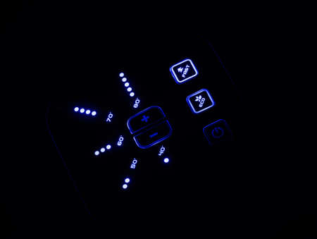 neon blue illuminated push buttons and indication on heater dashboard in dark