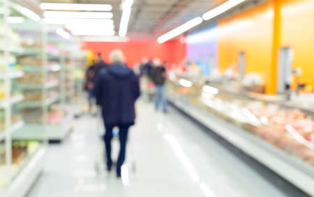 abstract defocused shoppers at supermarket Stock Photo