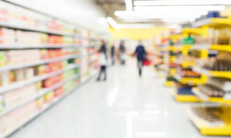 abstract defocused shoppers at supermarket