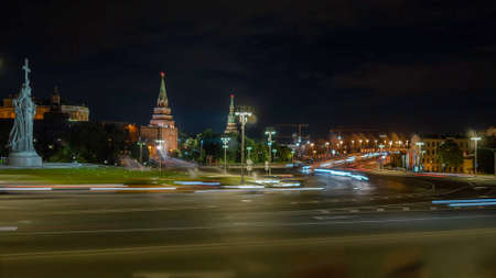 Moscow city road at night with view on Kremlin, night road in the centre of capital. City traffic near Moscow statue of Prince Vladimir and Kremlin