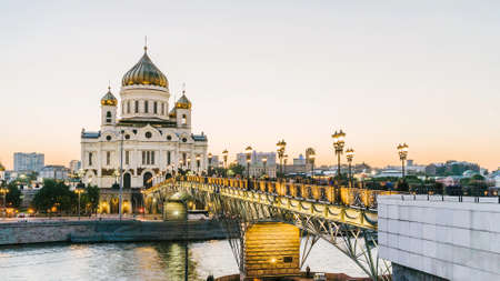 Sunset view of Cathedral of Christ the Savior and Moscow river in Moscow evening. Patriarshy Bridge and temple of christ in the centre of Moscow during sunset Stock fotó