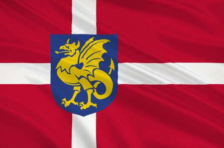 commune: Flag of Bornholm Danish municipality as part of the region Hovedstaden in Denmark. 3d illustration Stock Photo