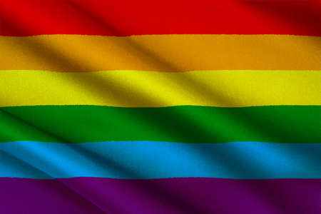 Rainbow Gay and LGBT Flag on texture satin cloth with the image of heart. 3D illustration Stock Photo
