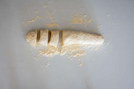 Dough kneaded in white background Imagens