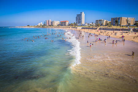 hobie: Port Elizabeth, South Africa - 18 JANUARY 2015, Look at the people on the beach waterfront of Port Elizabeth Stock Photo