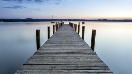 Sunset atmosphere  with a view on landing stage, at lake Starnberg