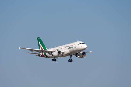 Munich, Germany - March 31. 2019: Alitalia Airbus A319-112 with the aircraft registration EI-IMD in the approach to the southern runway 08R of the Munich Airport MUC EDDM