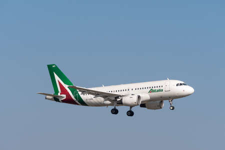Munich, Germany - March 31. 2019: Alitalia Airbus A319-112 with the aircraft registration EI-IMD in the approach to the southern runway 08R of the Munich Airport MUC EDDM Sajtókép
