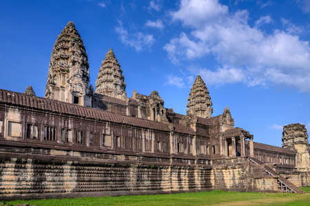 Angkor Wat (Constructed: Early-Mid 12th century, King / Patron: Suryavaman II, Religion: Hinduism) Angkor Wat is surrounded by a moat and an exterior wall measuring 1,300 meters x 1,500 meters. The temple itself is 1km square and consists of three levels  Редакционное