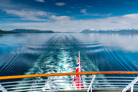 View from a ship of the Hurtigruten, the MS Polarlys, over the water into the distance