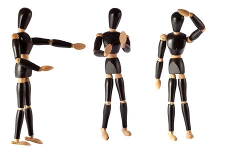 marioneta de madera: maniqu� de madera pintada de negro sobre un fondo blanco Foto de archivo