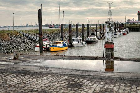 small recreational harbor boats overcast sky photo
