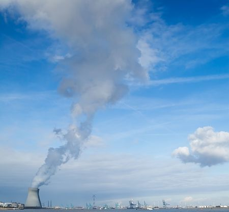 cooling towers of a nuclear power plant creating clouds in the Antwerp harbor Stock Photo - 5750458