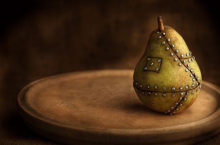 manipulated   alter: pear manipulated fruit with nails holding it together Stock Photo
