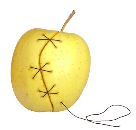 manipulated   alter: apple manipulated fruit with thread holding it together Stock Photo