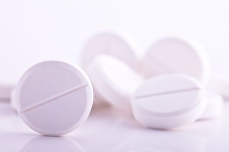 painkiller: round pills with low depth of field