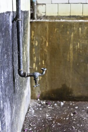 rusty water tap in old abandoned house Stock Photo - 6178099