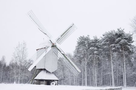 old wooden windmill covered in snow Stock Photo - 6178100