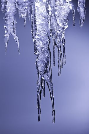 winter thaw: icicles sparkling white ice hanging down Stock Photo