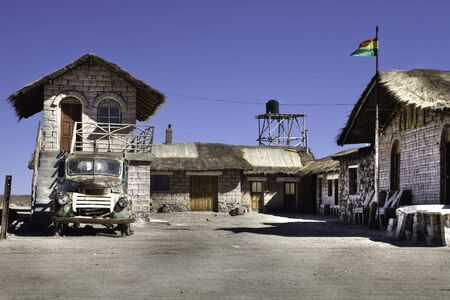 house built with salt in salar the uyuni bolivia old grunge car and bolivian flag Stock Photo - 6921508