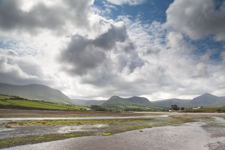 White clouds in blue sky over Irish hills and estuary at Dingle peninsula Kerry district Ireland Stock Photo - 7648344