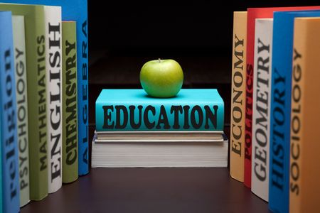 education study books with text learning building knowledge at school with healthy apple photo