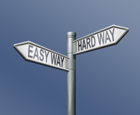 hard: easy and hard ward roadsign arrow on blue background Stock Photo