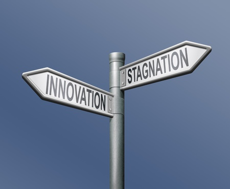 instigation: innovation stagnation road sign arrow progress or standing still innovate and move ahead become market leader