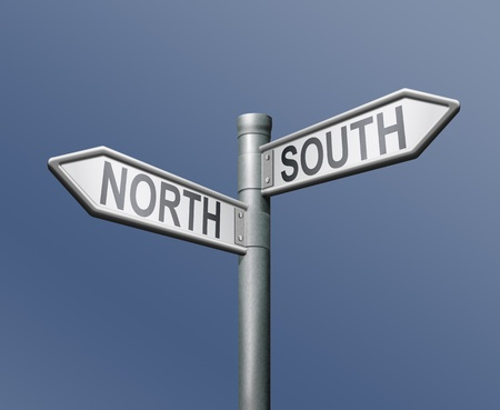 crossroad guide: north south road sign on blue background Stock Photo