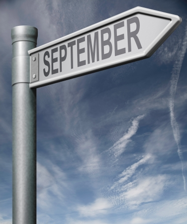 September sign  road sign arrow pointing towards the end of summer and the beginning of autumn back to school photo