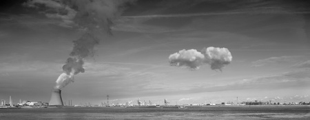 cooling towers of a nuclear power plant creating clouds in the Antwerp harbor Stock Photo - 9092706
